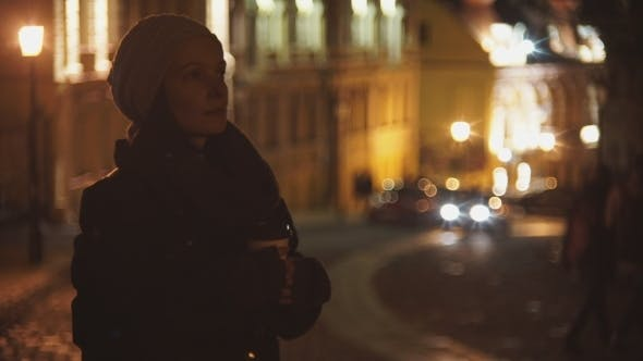 Thumbnail for The Girl On An Evening Street, Drinking Coffee