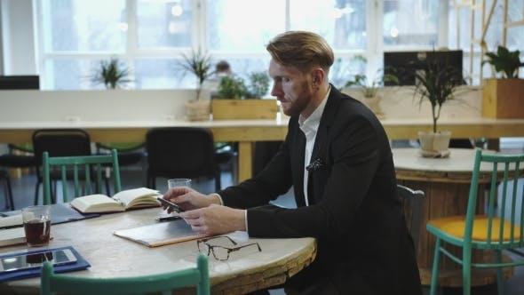 Thumbnail for Multitasking Man Working In Modern Office