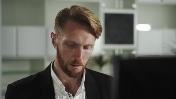 Thumbnail for Focused Man Working At a Computer
