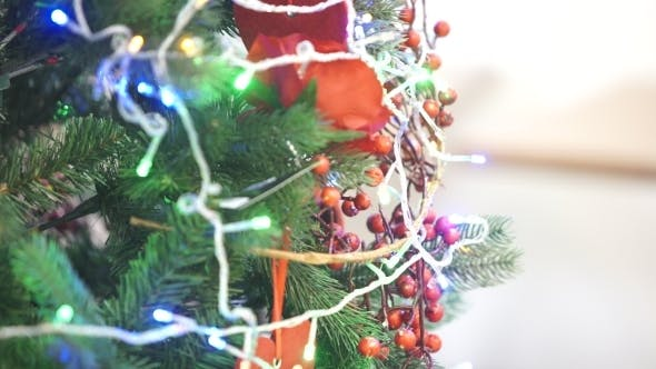 Cover Image for Christmas Tree Decorated With Garlands And Toys