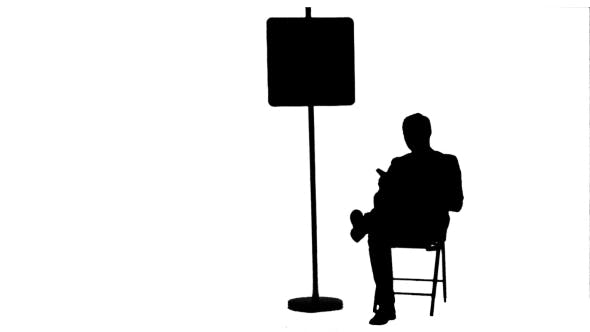 Thumbnail for Silhouette Businessman Reading a Book Near Parking