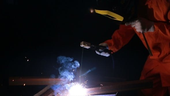 Thumbnail for Worker Holding Protection Mask Welding Metal