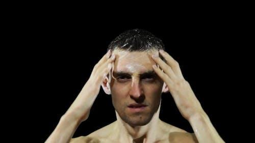 Young Man Washing Hair With Shampoo.