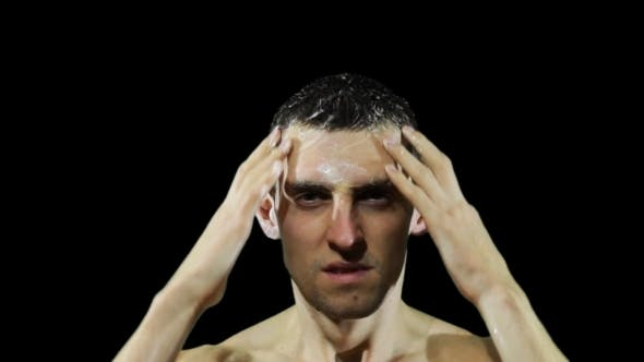 Thumbnail for Young Man Washing Hair With Shampoo.