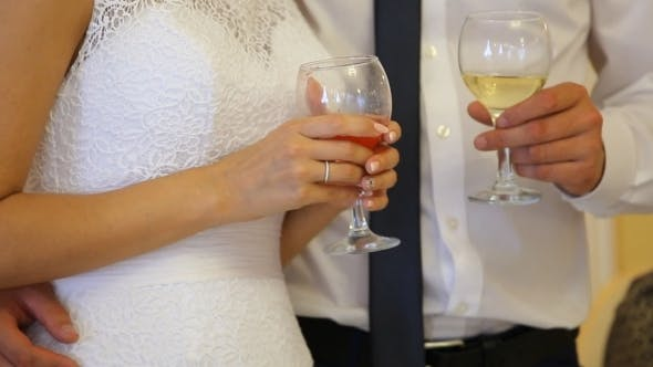 Thumbnail for The Bride And Groom Holding Glasses
