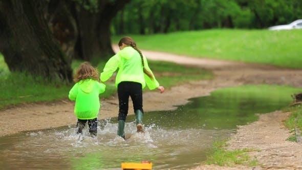 Thumbnail for Happy Children Running Through Huge Pool In Park