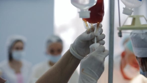 Thumbnail for Nurse Adjusting Infusion Blood With Against
