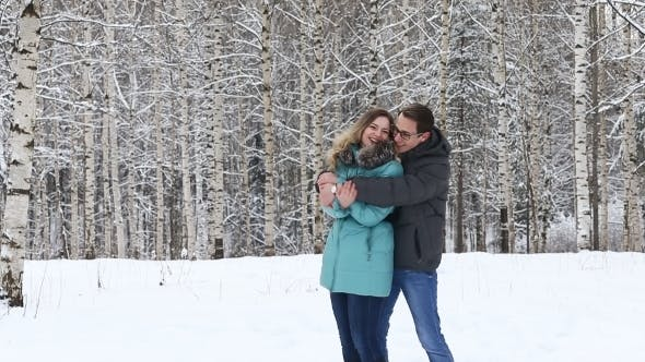 Thumbnail for Happy Young Couple Walking In a Winter Park.