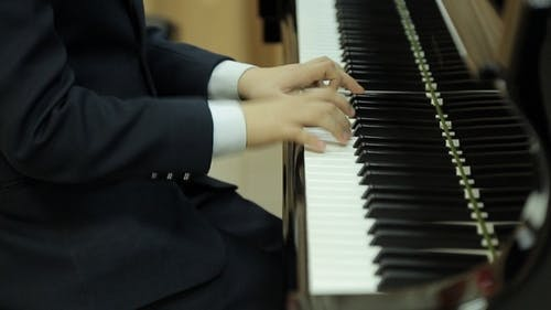 Boy Playing the Grand Piano
