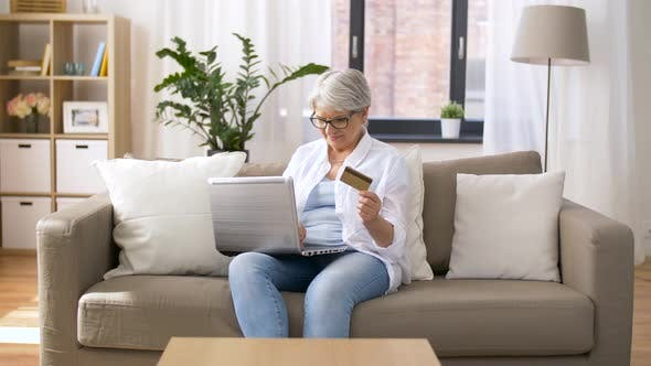 Thumbnail for Senior Woman with Laptop and Credit Card at Home