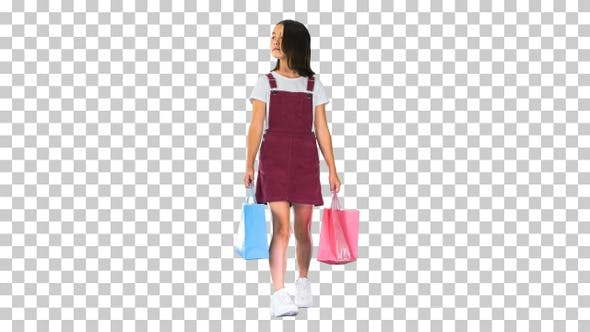 Little girl in casual walking with shopping bags, Alpha Channel
