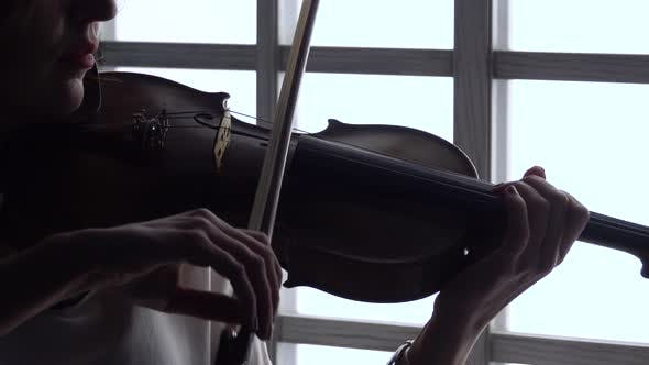 Thumbnail for Playing on Violin on the Background Window