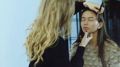 Makeup Artist At Work Puts Make-up