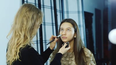 Makeup Artist At Work Puts Make-up