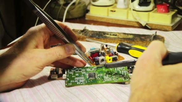 Thumbnail for Soldering Electronics On Circuit Board