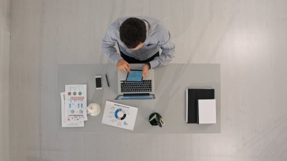 Thumbnail for Businessman Working With Tablet Computer