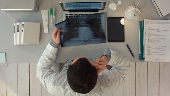 Radiologist Man Checking Xray