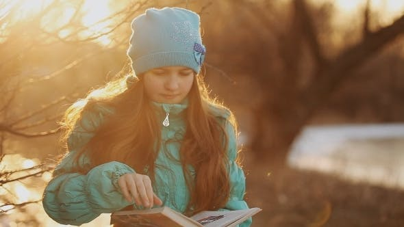 Thumbnail for Beautiful Little Girl Reading In Winter Park