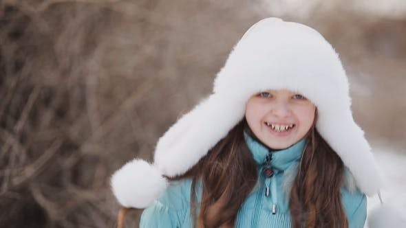 Cover Image for Beautiful  Little Girl Wearing Hat In Winter Park