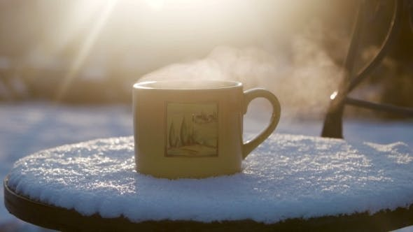 Thumbnail for Cup With Hot Tea Against The Sun In The Winter