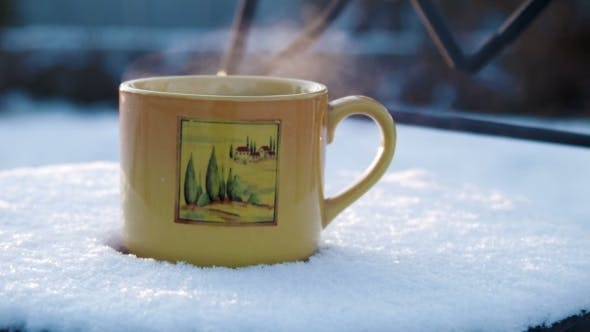 Thumbnail for Cup With Hot Tea On a Snow-covered Chair