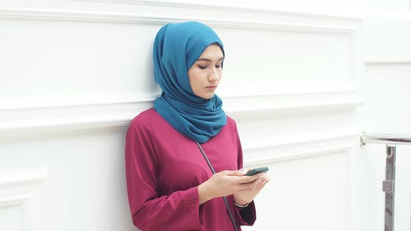 Thumbnail for Smartphone in the Hands of a Beautiful Arabian Woman Wearing a Hijab
