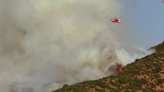 Thumbnail for Fire Helicopter on Its Work. Spraying the Water Over the Wildfire in Hollywood Hills
