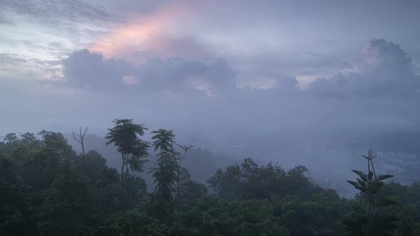 Timelapse Mist  attack the Penang hill at the early morning.