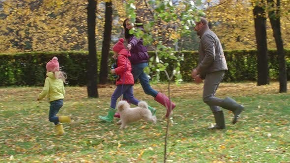 Thumbnail for Happy Family Running in Park