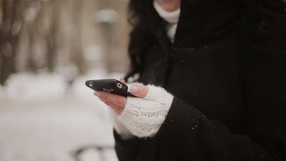 Thumbnail for Young Woman In Winter Park Talking Mobile Phone