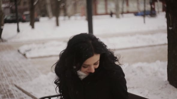 Thumbnail for Beautiful Young Girl Sits On The Bench Winter Park