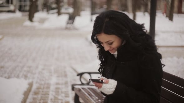 Cover Image for Woman In Winter Park Talking Mobile Phone