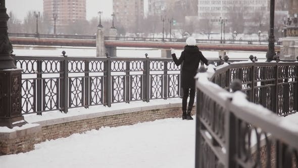 Thumbnail for Beautiful Happy Girl Runs On a Bridge In Winter
