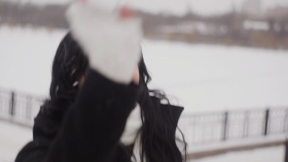 Cover Image for Happy Girl Playing Snowballs