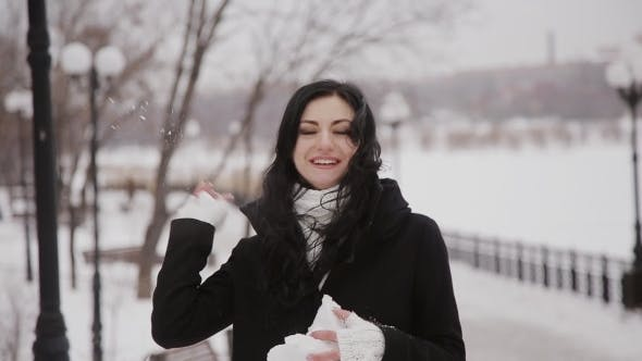 Thumbnail for Happy Girl Playing Snowballs