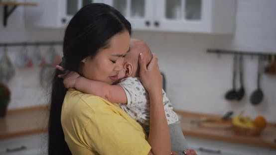 Thumbnail for Mother Holding Crying Baby in Arms
