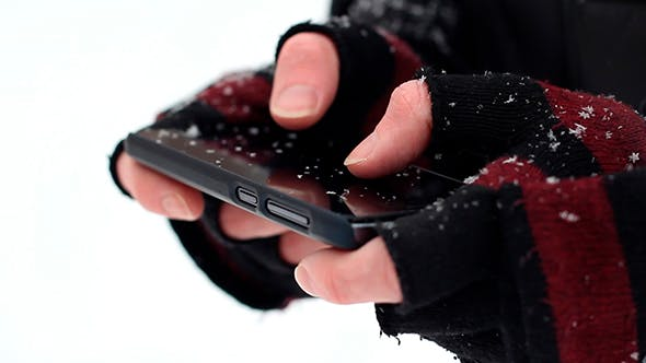 Thumbnail for Man Uses a Phone Winter