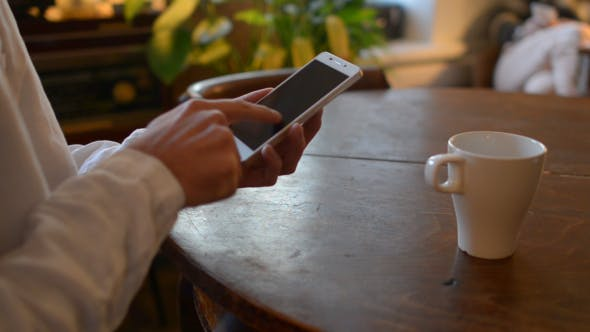 Thumbnail for Casual Man Using Smartphone on Table