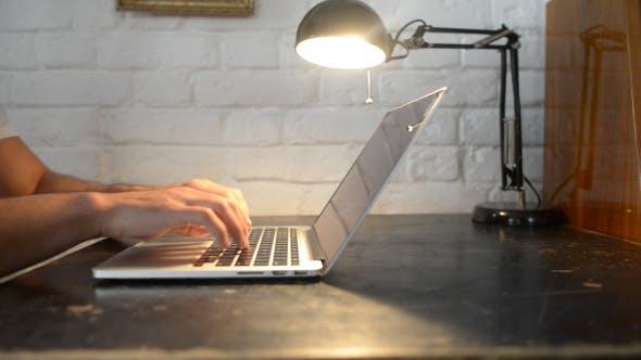 Thumbnail for Typing on Laptop, Lamp Light