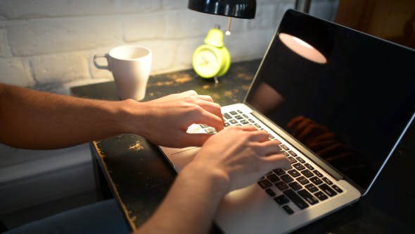 Thumbnail for Typing on Laptop, Under Lamp Light