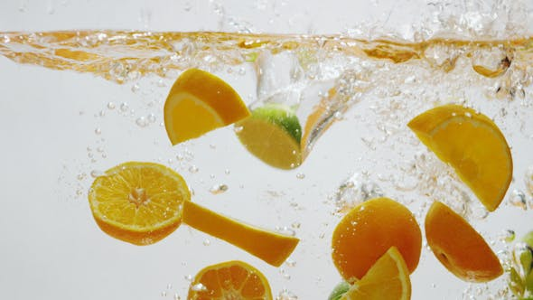 Thumbnail for Oranges and Limes Falling into Water