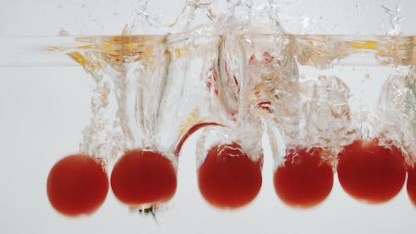 Thumbnail for Tomatos Falling into Water