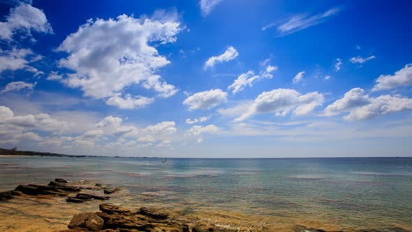 Thumbnail for Stones in Transparent Shallow Azure Sea Blue Sky White Clouds