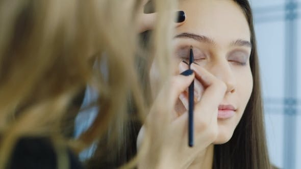 Thumbnail for A Young Girl Apply Makeup Around The Eyes