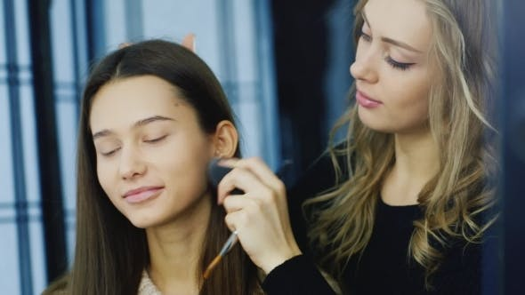 Thumbnail for An Attractive Dark-haired Girl Applied Make-up