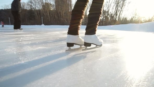 Thumbnail for Young Woman Skating On Ice With Figure Skates