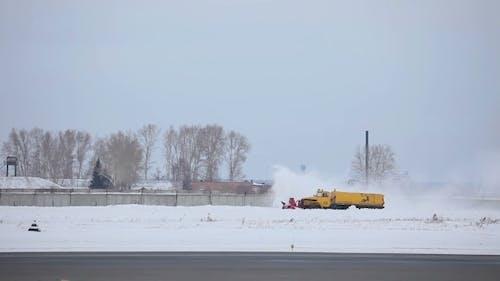 Snowplow Clears The Runway