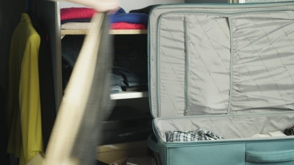 Thumbnail for The Woman Packs a Suitcase