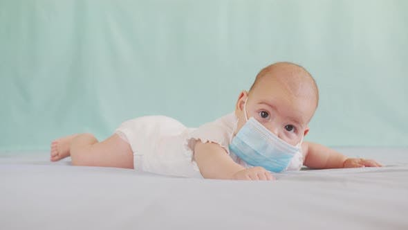 Thumbnail for Cute Infant Little Girl in a Protective Medical Mask. Happy Family. Prevention of Coronavirus or