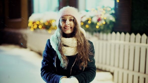 Thumbnail for Winter Christmas Girl. Beautiful Woman Blowing Snow